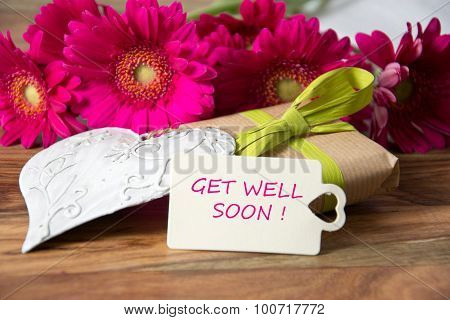 Flowers and greeting card with sample text - get well soon