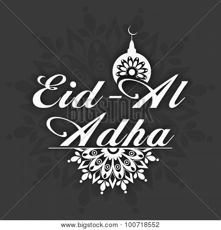 Stylish text Eid-Al-Adha with Mosque on floral design decorated background, can be used as greeting or invitation card design for Islamic Festival of Sacrifice celebration.
