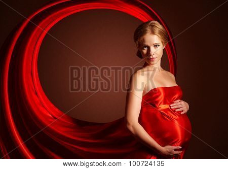 Beautiful Pregnant Woman In  Red Silk Dress Billowing