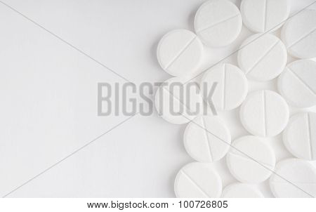 Top View Of The Spilled White Pills On The White Surface