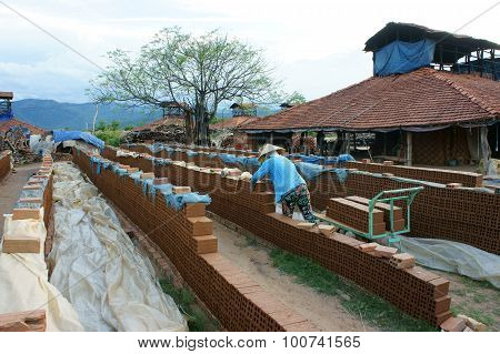 BINH DINH VIET NAM- AUG 22: Old brickwork at countryside Vietnamese trade village to product brick material for contruction make from soil burn by firewood ecology problem Vietnam Aug 22 2015 poster