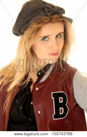 Girl Wearing Letterman Jacket And Hat With An Attitude