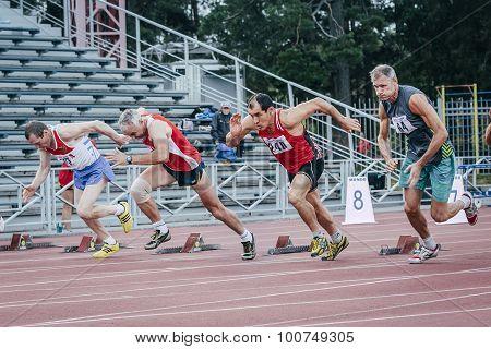 start of old men's 100 meters