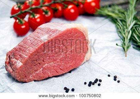 A Pieces Of Fresh Meat, Beef Slab, Decorated With Greens And Vegetables