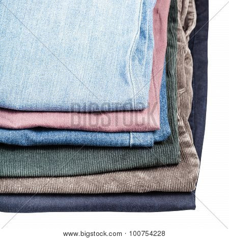 Stack Of Different Jeans And Corduroys Close Up
