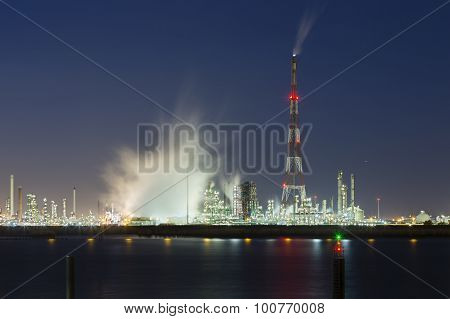 Flare Stack And Harbor Industry At Night