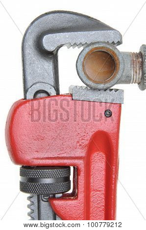 Red plumbers pipe wrench and plumbing component