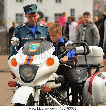 Orel, Russia, September 5, 2015: Boy Sitting On Rescue Team Motobike