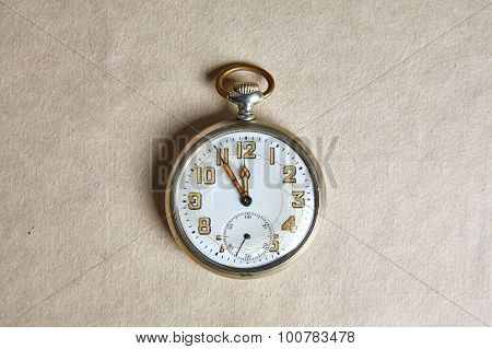 Old Pocket Watch On Old Paper