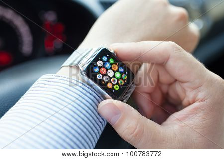 Man Hand In The Car With Apple Watch And Icon