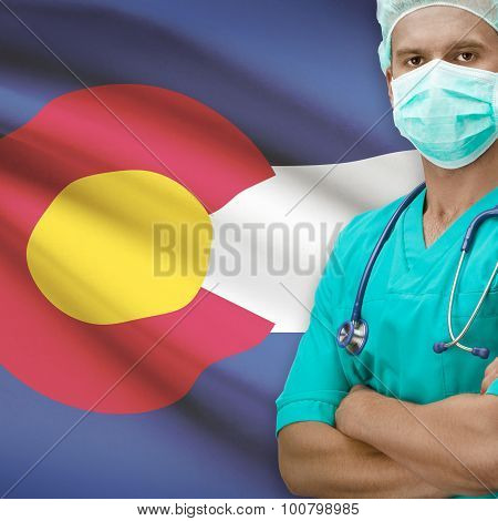 Surgeon with USA states flags on background - Colorado poster