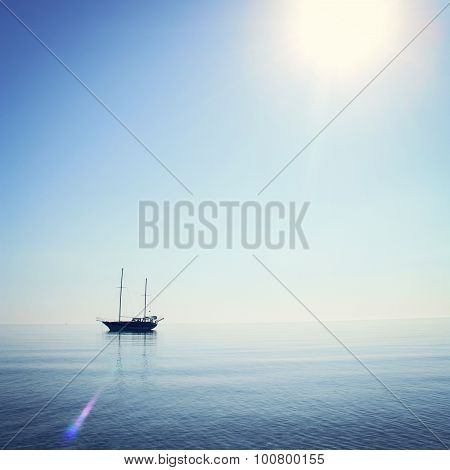 Morning Sea With Boat On The Horizon. Aged Photo.