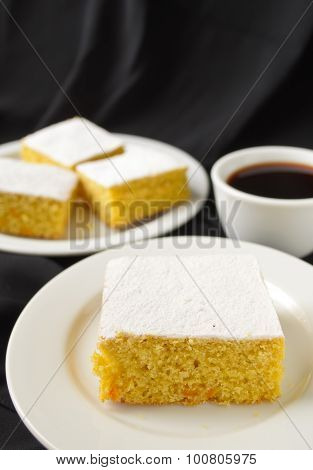 manna cake with candied fruits and coffee on black background