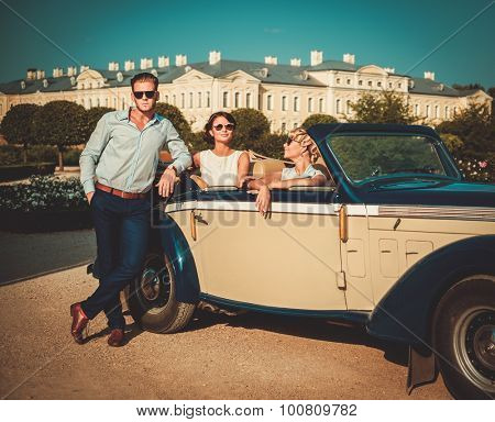 Wealthy friends in a classic convertible  poster