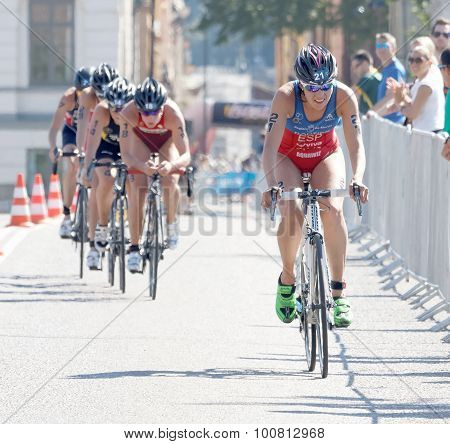 Triathlete Carolina Routier Cycling, Followed By Competitors