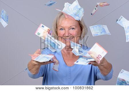 Excited Senior Lady Celebrating A Windfall