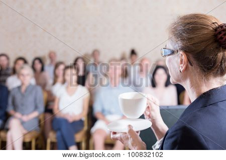 Female Lecturer Drinking Coffee