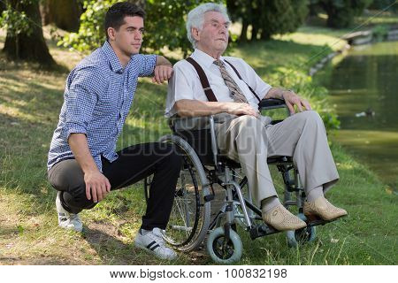 Retired Person And Male Carer