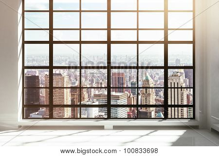 Empty Loft Interior With City View