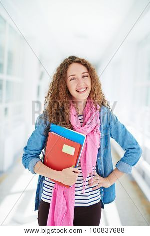 Pretty college learner looking at camera with smile