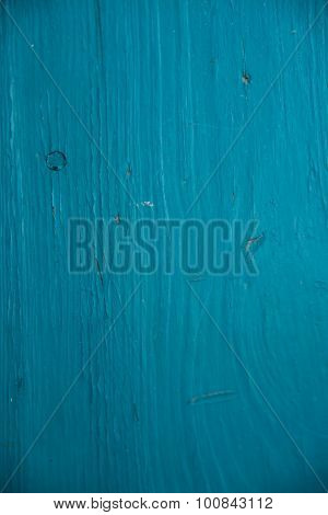 Impressive cracked earth.Texture and texture the surface of the earth.Wooden Board painted in the blue color