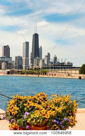 CHICAGO, ILLINOIS - AUGUST 22, 2015: Chicago skyline seen from Navy Pier. The John Hancock Center the 6th tallest building in the USA rises above surrounding structures.