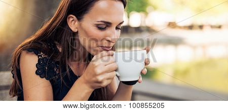 Young Woman Drinking Cappuccino