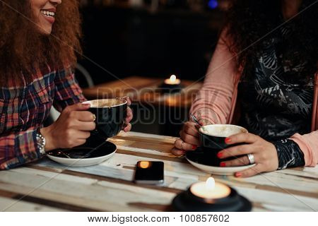 Friends Drinking Coffee At A Cafe