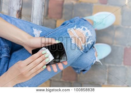 Female Hands Wipe The Touch Screen Phone Antibacterial Wipes