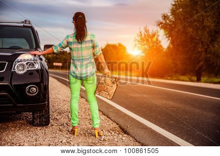 Woman out of gas standing by the road