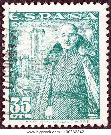 SPAIN - CIRCA 1948: A stamp printed in Spain shows General Franco and Castillo de la Mota