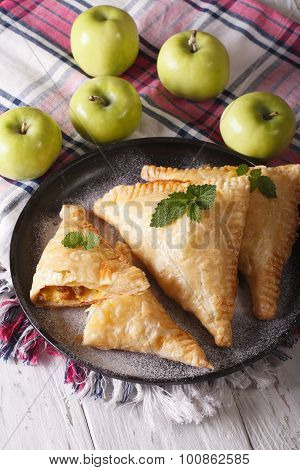 Delicious Pie Turnover With Apples And Raisins Close-up. Vertical