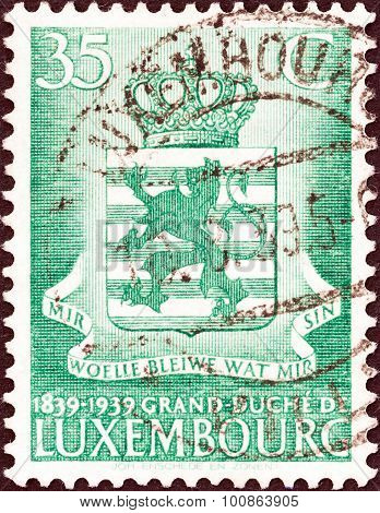 LUXEMBOURG - CIRCA 1939: A stamp printed in Luxembourg shows Arms of Luxembourg