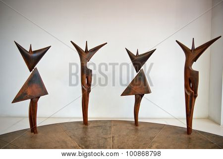 BARCELONA, SPAIN - MAY 02: Set of modernist figural sculptures of a line of men alternating with woman as an architectural feature in Espanyol Poble, Barcelona , Spain. May 02, 2015.