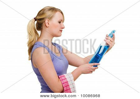 Woman Looking At Cleaning Fluid Against White Background