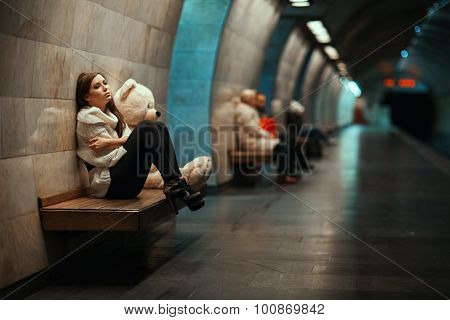 Sad Woman Sitting On A Bench In The Subway.
