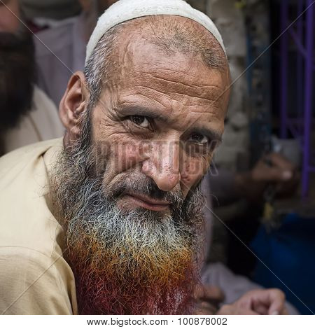 Pashto immigrant in Pakistan with henna dyed beard