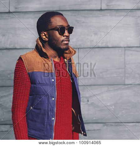 Portrait Fashion Stylish Young African Man Wearing A Sunglasses And Sweater With Vest Jacket In The
