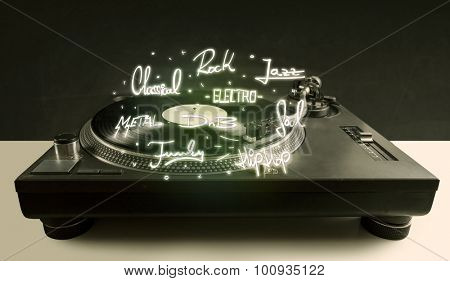 Turntable with vinyl and music genres writen concept on background