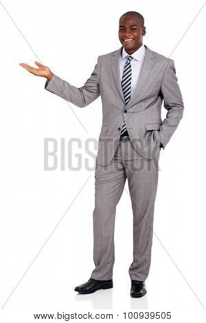 good looking african businessman presenting on white background