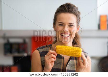 Smiling Woman Holding Corn Cob