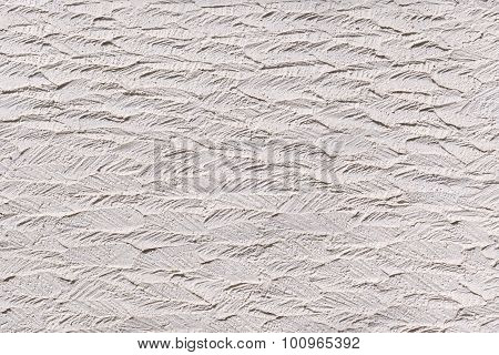 White plasterwork with abstract texture