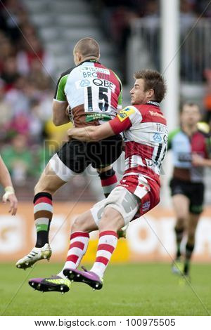 TWICKENHAM, ENGLAND. 17 SEPTEMBER 2011. Harlequins Mike Brown, is tackled illegally in the air by Gloucester's Henry Trinder, during the premiership rugby union match between Harlequins and Gloucester