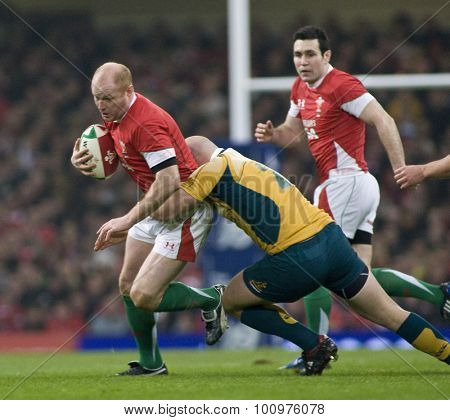 CARDIFF, WALES. 28 NOVEMBER 2009. Martyn Williams of Wales is tackled by Stephen Moore playing for Australia  while playing in the International Rugby Union match between Wales and Australia