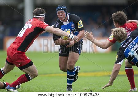 BATH, ENGLAND. 10 SEPTEMBER 2011  Saracen's Andy Saull, tackles Bath's Pieter Dixon, during the Aviva Premiership match between Bath and Saracens at the Recreation Ground Bath England.