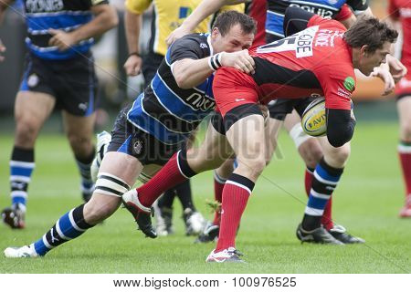 BATH, ENGLAND. 10 SEPTEMBER 2011  Saracen's Alex Goode, gets tackled during the Aviva Premiership match between Bath and Saracens at the Recreation Ground Bath England.