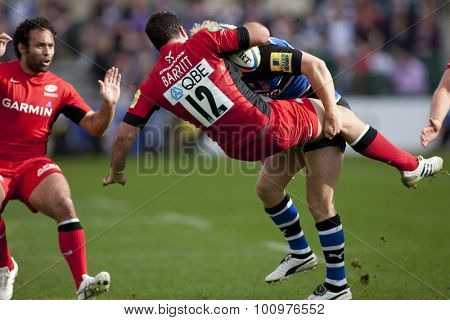 BATH, ENGLAND. 10 SEPTEMBER 2011  Saracen's Brad Barritt, gets tackled by Bath's Nick Abendanon,  during the Aviva Premiership match between Bath and Saracens at the Recreation Ground Bath England.