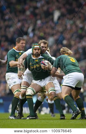 TWICKENHAM LONDON, 27 NOVEMBER 2010.  South Africa's Victor Matfield , is tackled by England's Tom Croft, as South Africa's Jannie du Plessis, approaches during the Investec International match