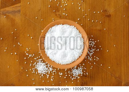 Coarse grained salt in terracotta bowl