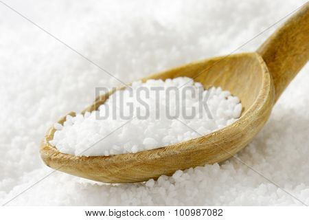 Detail of coarse grained salt and wooden spoon